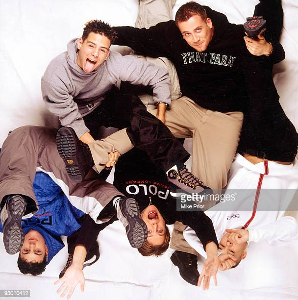 Richard 'Abs' Brown Scott Robinson Ritchie Neville Jason J Brown and Sean Conlon of the boy band 5ive pose for a studio group portrait c 1998 in...