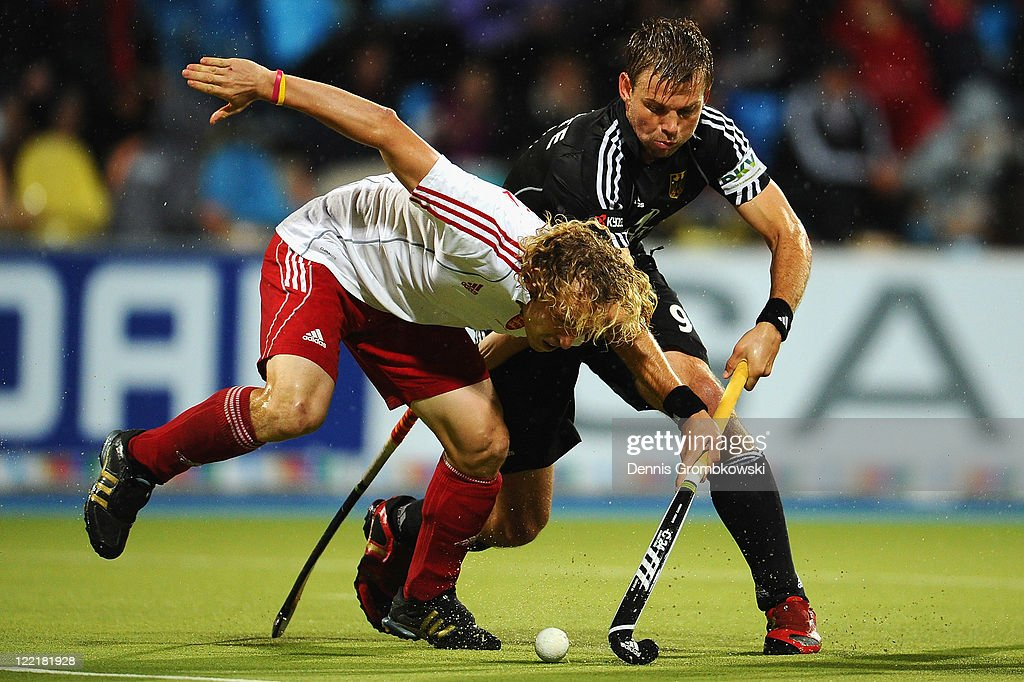 <a gi-track='captionPersonalityLinkClicked' href=/galleries/search?phrase=Richard+Alexander&family=editorial&specificpeople=212963 ng-click='$event.stopPropagation()'>Richard Alexander</a> (L) of England challenges Moritz Fuerste (R) of Germany during the Men's Eurohockey 2011 semi final match between Germany and England at Warsteiner HockeyPark on August 26, 2011 in Moenchengladbach, Germany.