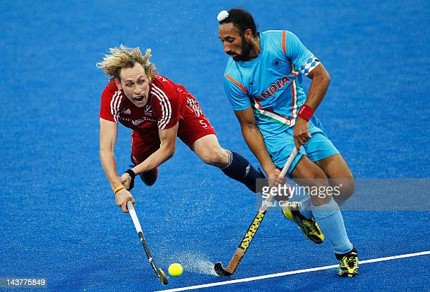 Richard Alexander of Great Britain battles for the ball with Sardar Singh of India during the Men's preliminary match between Great Britain and India...