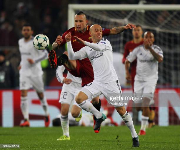 Richard Almeida of Qarabag FK competes for the ball with Radja Nainggolan of AS Roma during the UEFA Champions League group C match between AS Roma...