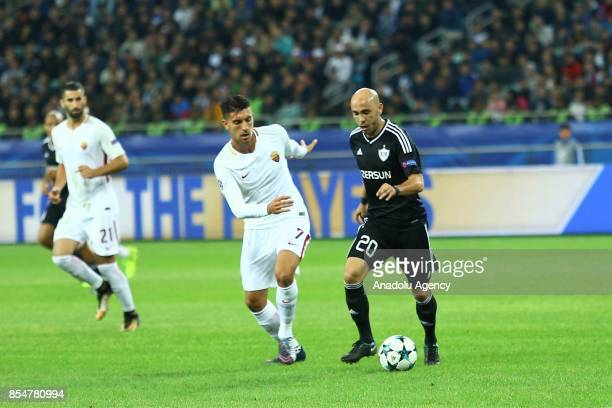 Richard Almeida of Qarabag in action against Lorenzo Pellegrini of AS Roma during the UEFA Champions League Group C football match between Qarabag FK...