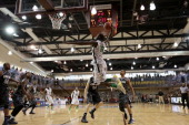 Richard Amardi of the Oregon Ducks slam dunks against the Georgetown Hoyas during the Armed Forces Classic at United States Army GarrisonHumphreys on...