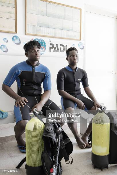 Richard Amegah immigrant from Ghana and Boubacar Barry immigrant from Senegal are portrayed during a briefing with their instructors before a diving...