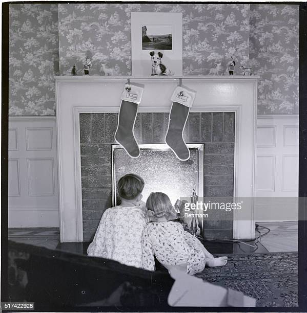 Richard and Diane Burnham 'Christmas Eve' in front of fireplace Undated photograph