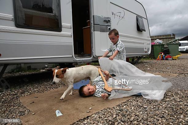 Richard and John 'Button' Sheridan aged 2 play with bubblewrap outside their caravan at Dale Farm on September 4 2011 near Basildon England Hundreds...
