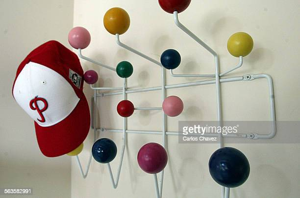 Richard and Kathryn Waltzer of Pacific Palisades have a Ray and Charles Eames designed 'Hang it All' for their hats by their front door