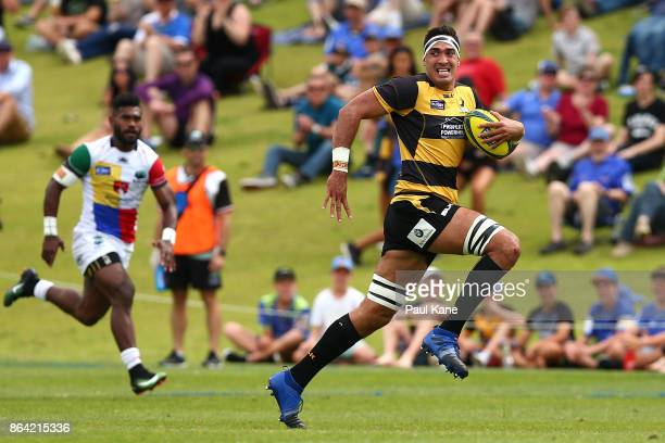 Richard Arnold of the Spirit runs the ball down thw wing during the round eight NRC match between Perth and the Sydney Rays at McGillivray Oval on...