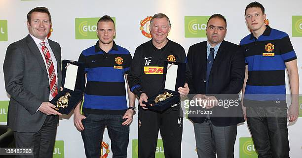 Richard Arnold Tom Cleverley Sir Alex Ferguson and Phil Jones of Manchester United are presented with gifts by Haris Kotsibos CEO of Globul after a...