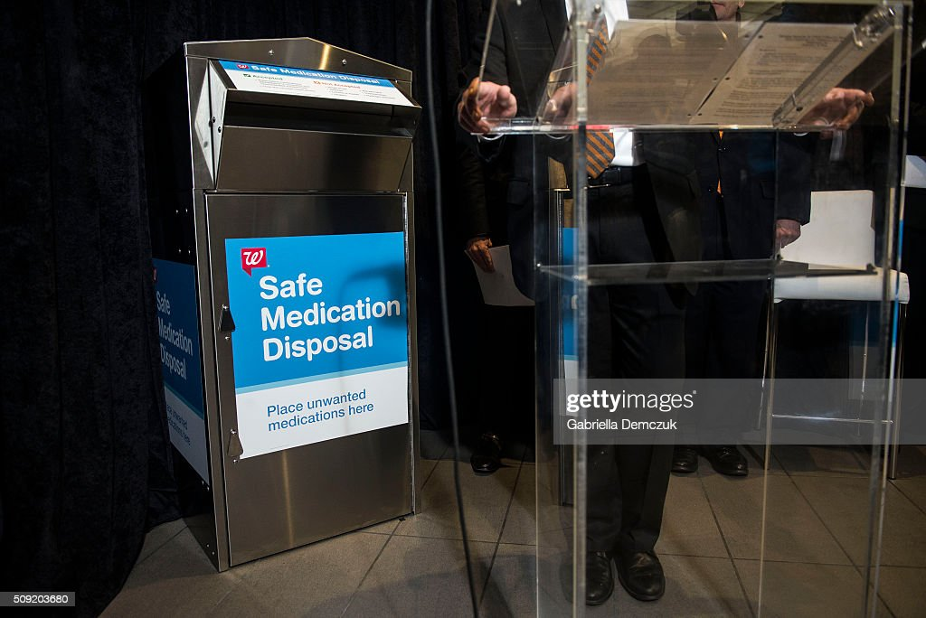 Richard Ashworth, president for pharmacy and retail operations at Walgreens, stands next to a Safe Medication Disposal box during an event unveiling a multi-state program to combat opioid abuse in the U.S. at a Walgreens store on February 9, 2016 in Washington, DC. More than 500 Walgreens drugstores will have safe medication disposal kiosks installed, and livesaving opioid antidote naloxone will be made available without prescription in 35 states throughout the U.S.