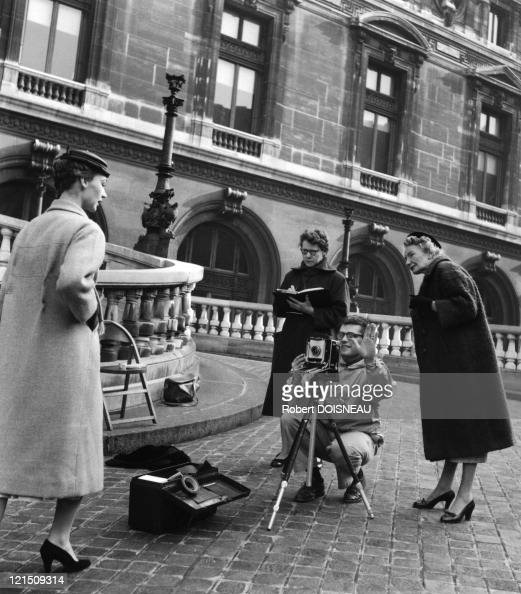 Richard Avedon Shooting Session With A Dior Model In Front Of The Opera De Paris 1953