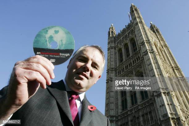Richard Bacon MP holds a DVD copy of the film An Inconvenient Trough part of a documentary series detailing pig farmers struggle to remain in...