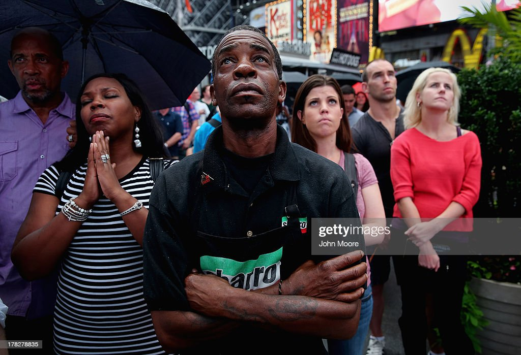 Richard Bailey, from Hempstead, New York, watches a giant screen in Times Square as U.S. President Barack Obama speaks on the 50th anniversary of Martin Luther King Jr.'s 'I Have a Dream' speech on August 28, 2013 in New York City. With the official ceremony in Washington D.C., a crowd gathered in Manhattan's Times Square to watch the President's speech broadcast live and commemorate the anniversary of what is seen as one of the most important days in the history of American civil rights.