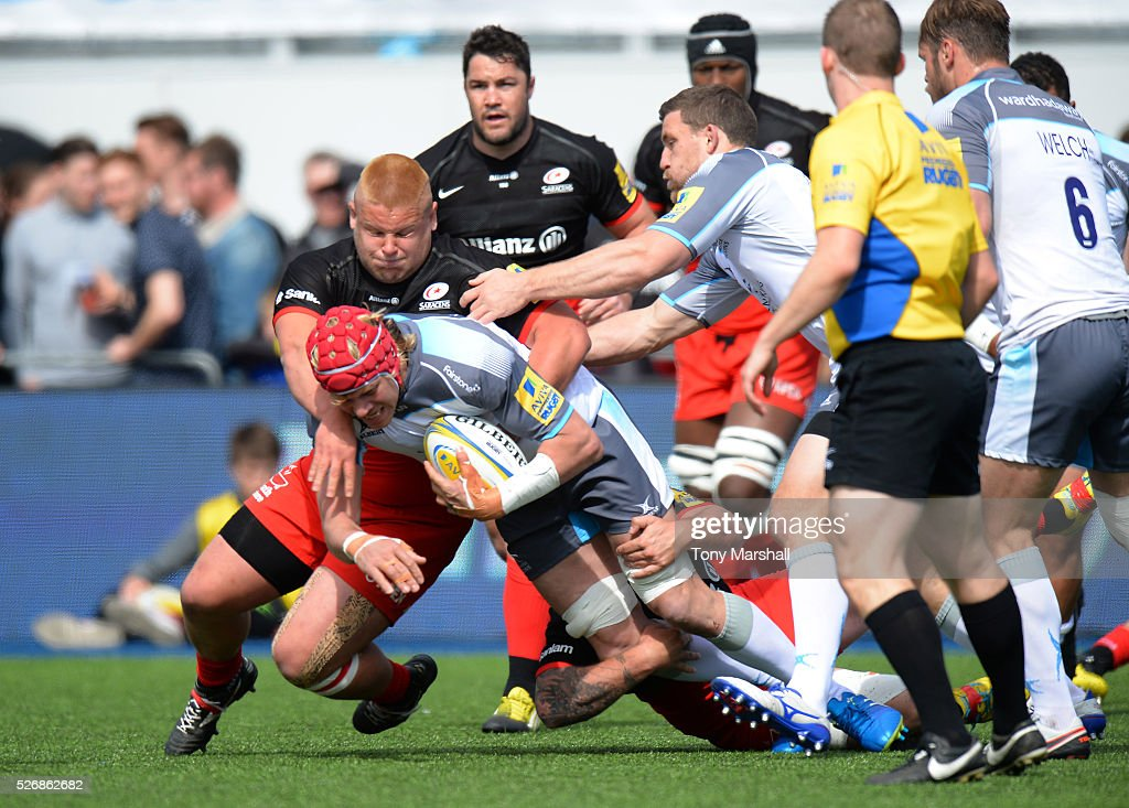 Richard Barrington of Saracens tackles <a gi-track='captionPersonalityLinkClicked' href=/galleries/search?phrase=Mouritz+Botha&family=editorial&specificpeople=6234514 ng-click='$event.stopPropagation()'>Mouritz Botha</a> of Newcastle Falcons during the Aviva Premiership match between Saracens and Newcastle Falcons at Allianz Park on May 1, 2016 in Barnet, England.
