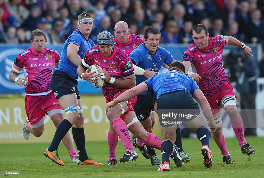 Richard Baxter of Exeter Chiefs is tackled by <a gi-track='captionPersonalityLinkClicked' href=/galleries/search?phrase=Cian+Healy&family=editorial&specificpeople=4166531 ng-click='$event.stopPropagation()'>Cian Healy</a> of Leinster during the Heineken Cup Pool 5 match between Leinster and Exeter Chiefs at Royal Dublin Society on October 13, 2012 in Dublin, Ireland.