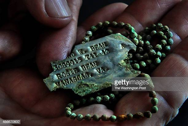Richard bean holds the dog tags of his uncle Richard N Bean that were found on the island of Saipan Richard Bean of Nokesville Va is the nephew of...