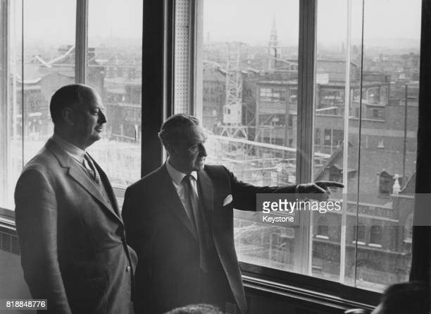 Richard Beeching Baron Beeching chairman of the British Transport Commission with Ernest Marples the Minister of Transport at the Transport Ministry...