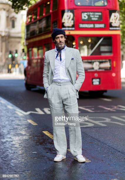 Richard Biedul wearing beanie and a suit during the London Fashion Week Men's June 2017 collections on June 9 2017 in London England