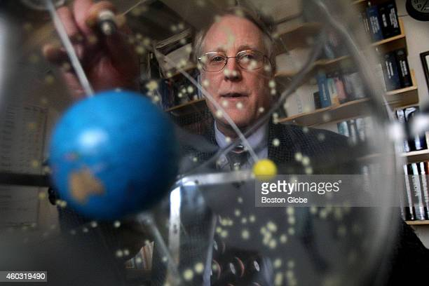 Richard Binzel a professor of planetary sciences at MIT who is part of a team working on a NASA mission to Pluto This is a globe of the solar system