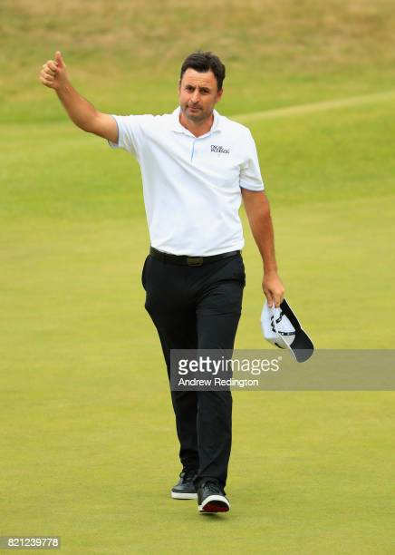 Richard Bland of England acknowledges the crowd on the 18th hole during the final round of the 146th Open Championship at Royal Birkdale on July 23...