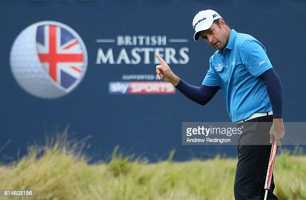 Richard Bland of England takes a one shot lead after making a birdie putt on the 18th hole during the second round of the British Masters at The...