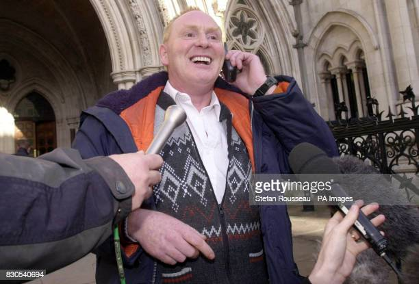 Richard Brailsford a friend of Stephen Downing celebrates the release on bail of Stephen at the Courts of Appeal in central London Downing was being...