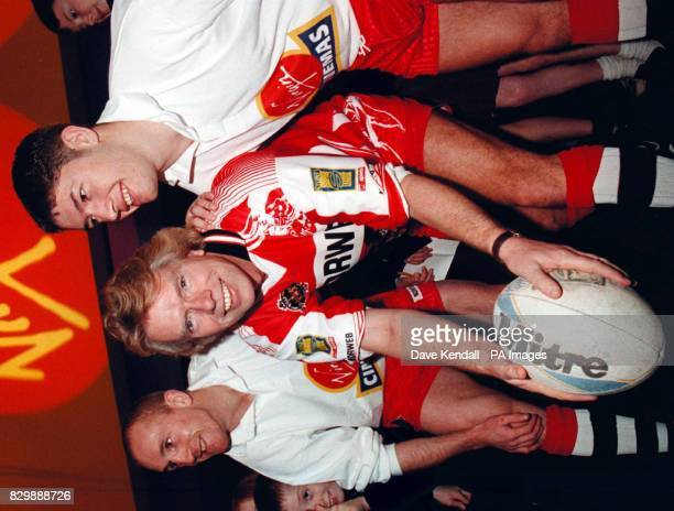 Richard Branson aided by Wigan RLFC players Shaun Edwards and Steven Holgate dons the jersey of the Wigan Rugby League Club for the opening of...