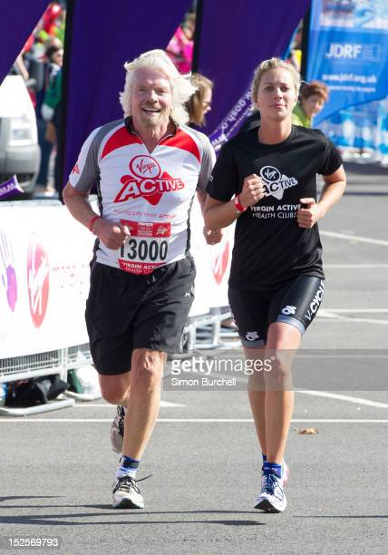 Richard Branson and Holly Branson competing in the Virgin Active London Triathlon at ExCel on September 22 2012 in London England