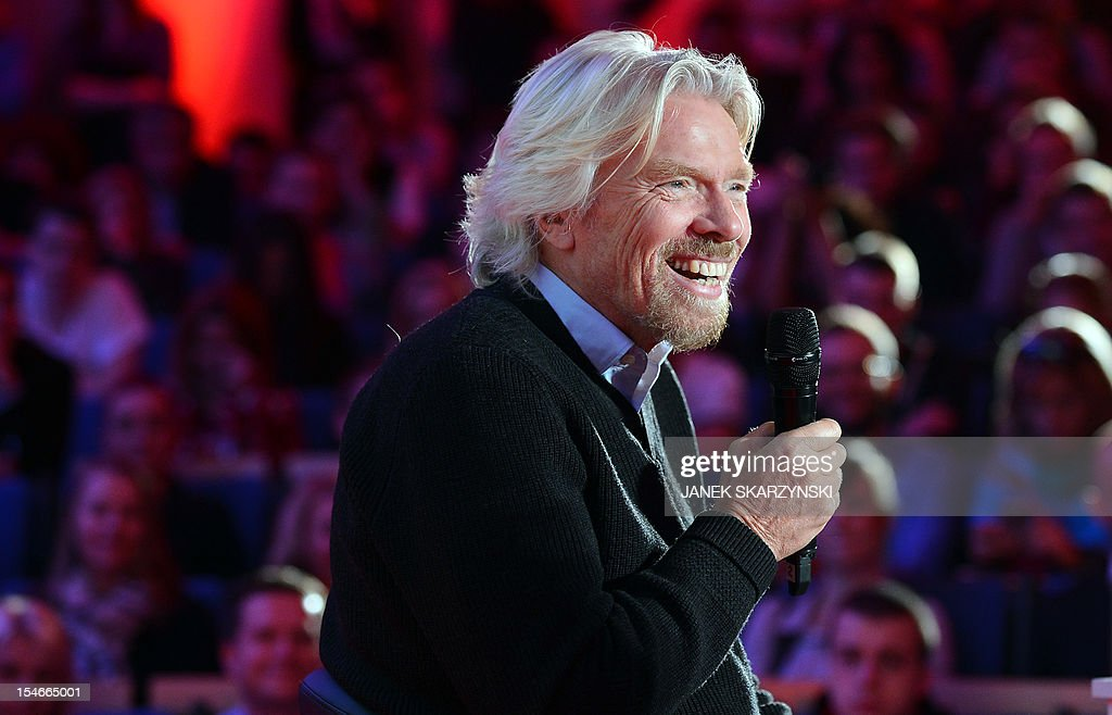Richard Branson, chairman and founder of Virgin Group attends a meeting with students at Warsaw university on October 24, 2012.