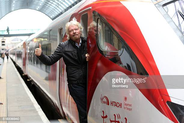 Richard Branson chairman and founder of Virgin Group Ltd poses for a photograph on board a new Virgin Azuma high speed train manufactured by Hitachi...