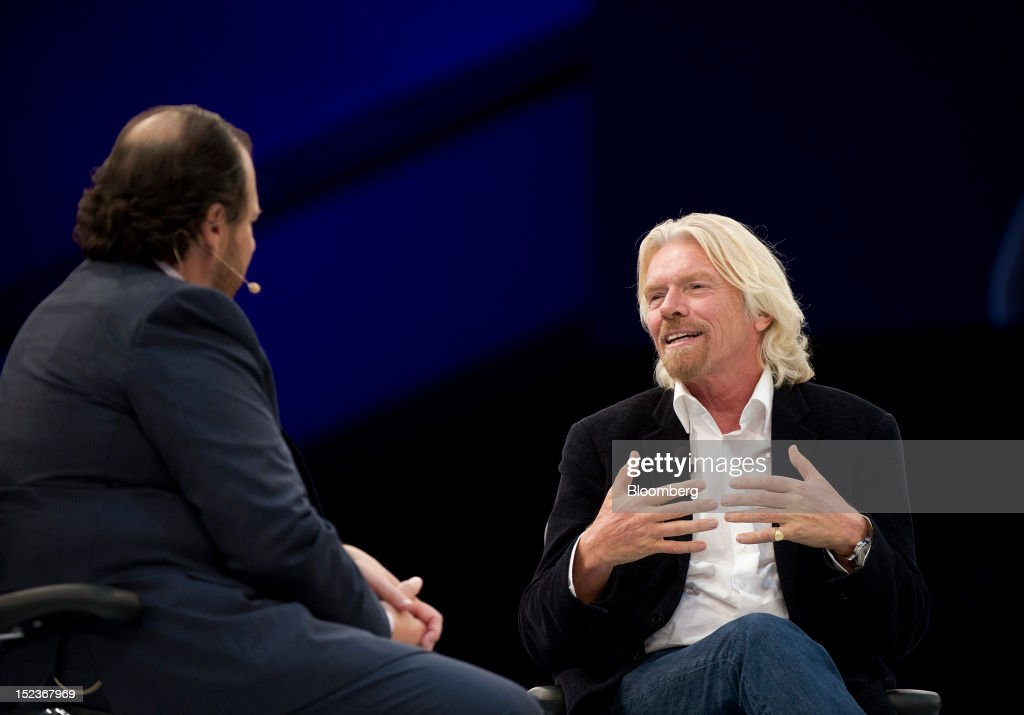 <a gi-track='captionPersonalityLinkClicked' href=/galleries/search?phrase=Richard+Branson&family=editorial&specificpeople=220198 ng-click='$event.stopPropagation()'>Richard Branson</a>, chairman and founder of Virgin Group Ltd., right, speaks with Marc Benioff, chairman and chief executive officer of Salesforce.com Inc., during a keynote address at the DreamForce Conference in San Francisco, California, U.S., on Wednesday, Sept. 19, 2012. Salesforce.com Inc. said it's releasing a new version of its software for tablet computers and unifying its social-media marketing products into a single suite, as it races to stay ahead of new market entrants. Photographer: David Paul Morris/Bloomberg via Getty Images