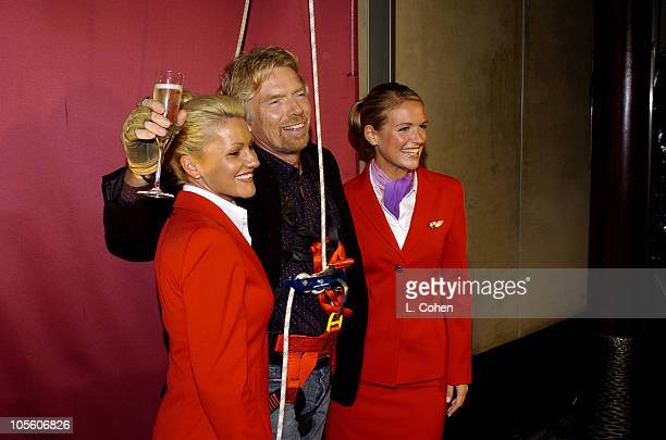 Richard Branson of 'Rebel Billionaire Branson's Quest for the Best' with stewardess after scaling down a building