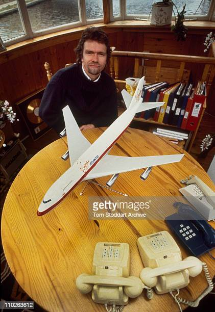 Richard Branson photographed with a model of a plane just weeks before the launch of his Virgin Atlantic airline on 22nd of June 1984 The businessman...