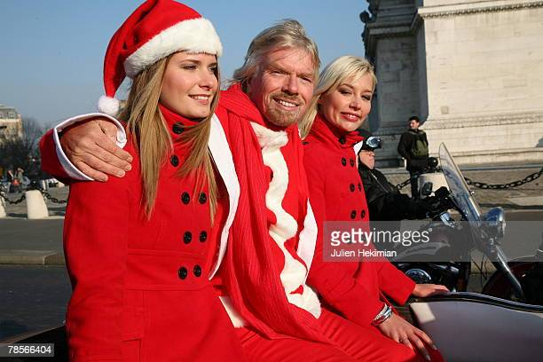 Richard Branson wearing a Santa suit travels in a sports car along the ChampsElysees Avenue past the landmark l' Arc de Triomphe on December 19 2007...