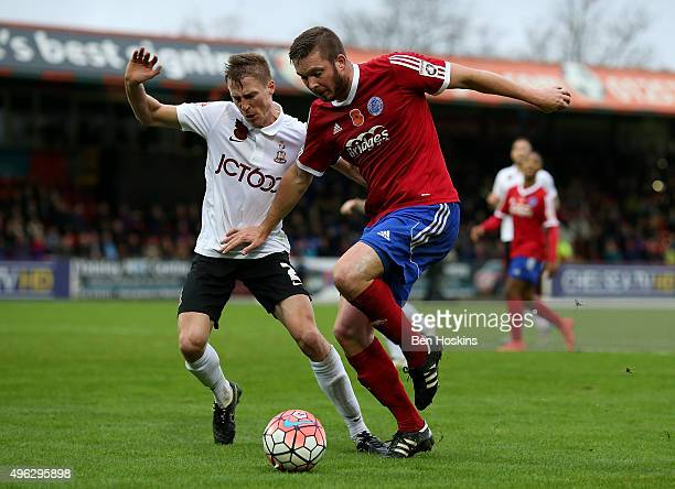 Richard Brodie of Aldershot holds off the challenge of Stephen Darby of Bradford during The Emirates FA Cup First Round match between Aldershot Town...