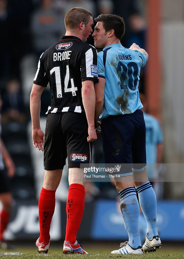 Richard Brodie (L) of Grimsby clashes with Lee Burns of Dartford during the FA Trophy semi final match between Grimsby Town v Dartford at Blundell Park on February 16, 2013 in Grimsby, England.