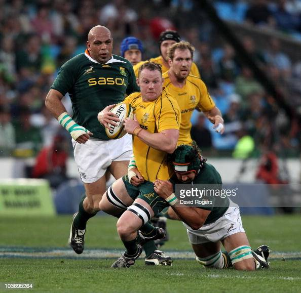 Richard Brown of the Wallabies is tackled by Victor Matfield during the 2010 TriNations match between the South African Springboks and the Australian...