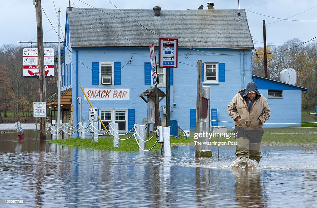 Richard Brown who manages White's Ferry wades through the flood waters of the Potomac Wednesday October 31 2012 in White's Ferry MD As far as...