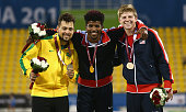 Richard Browne of the United States poses with his gold Alan Oliveira of Brazil silver and Hunter Woodhall of the United States bronze afterthe men's...