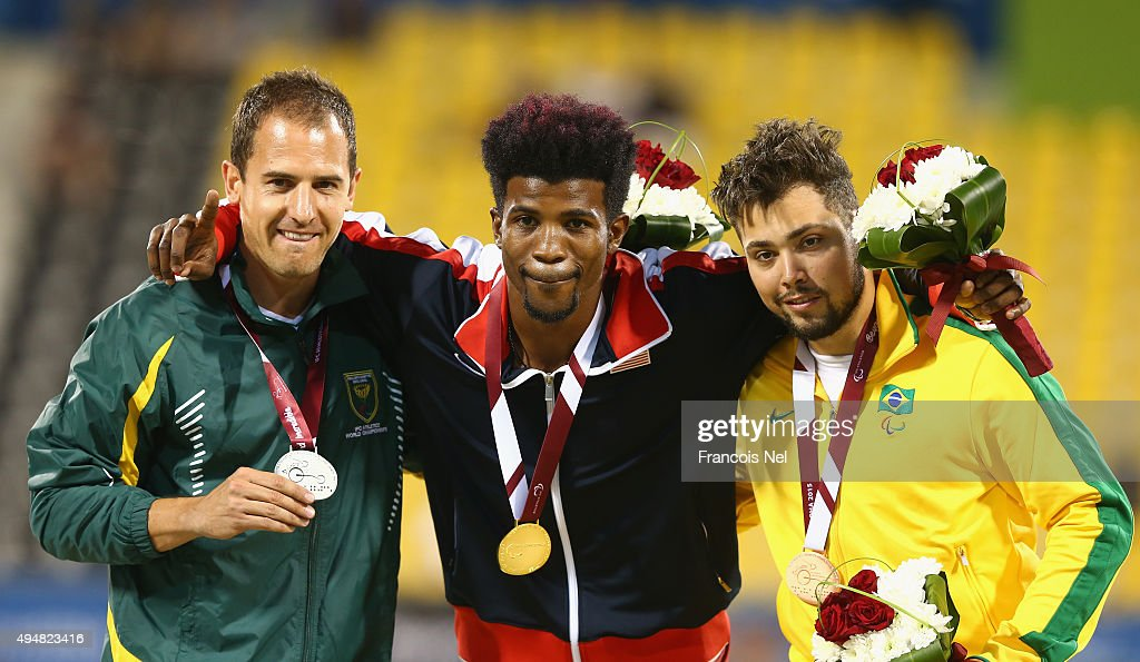 Richard Browne of the United States poses with his gold meda Arnu Fourie of South Africa silver and Alan Oliveira of Brazil bronze for the men's 100m...