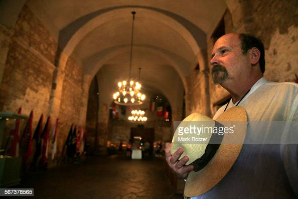 Richard Bruce Winders Curator at the Alamo watches over the displays in the Shrine September 16 2014 The main building at the Alamo is called the...