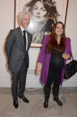 Richard Buckley and Paloma Bailey attend a private view of Bailey's Stardust a exhibition of images by David Bailey supported by Hugo Boss at the...