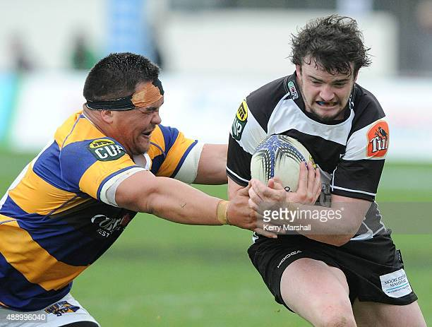 Richard Buckman of Hawkes Bay makes a break past Mike Kainga of the Bay of Plenty during the ITM Cup match between Hawke's Bay and Bay of Plenty on...