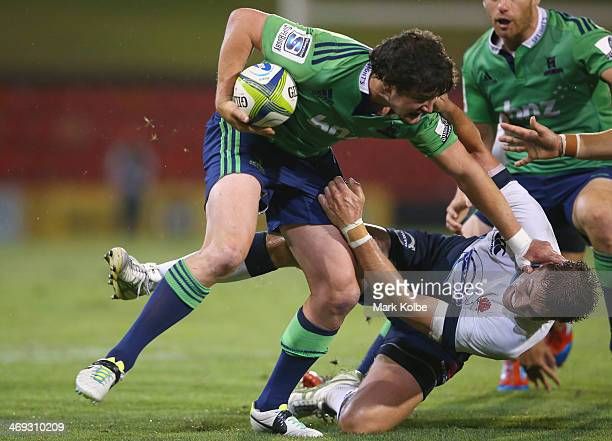 Richard Buckman of the Highlanders fends off the tackle of Cam Crawford of the Waratahs during the Super Rugby trial match between the Waratahs and...