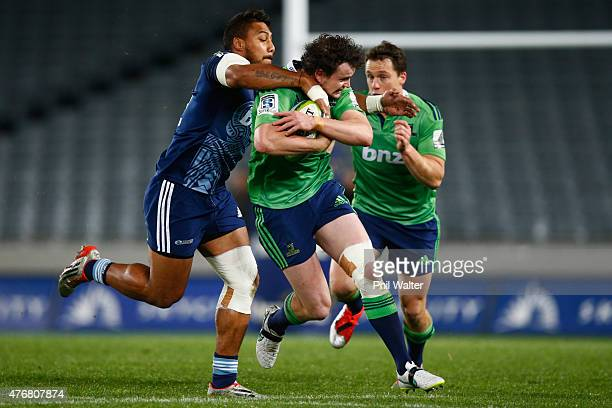 Richard Buckman of the Highlanders is tackled by George Moala of the Blues during the round 18 Super Rugby match between the Blues and the...