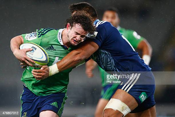 Richard Buckman of the Highlanders is tackled during the round 18 Super Rugby match between the Blues and the Highlanders at Eden Park on June 12...