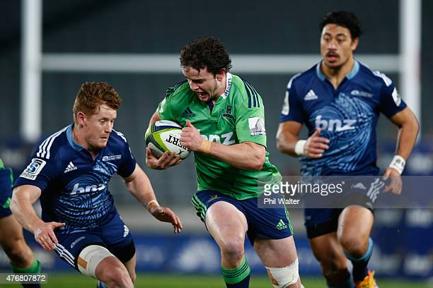 Richard Buckman of the Highlanders makes a break during the round 18 Super Rugby match between the Blues and the Highlanders at Eden Park on June 12...