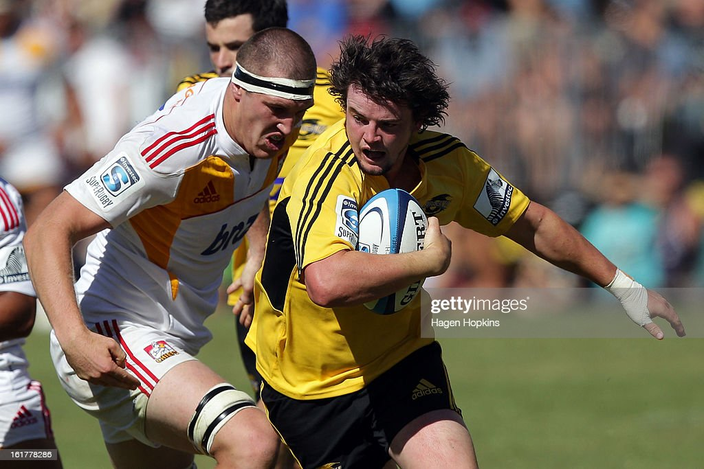 Richard Buckman of the Hurricanes is tackled by Brodie Retallick of the Chiefs during the Super Rugby trial match between the Hurricanes and the Chiefs at Mangatainoka RFC on February 16, 2013 in Mangatainoka, New Zealand.