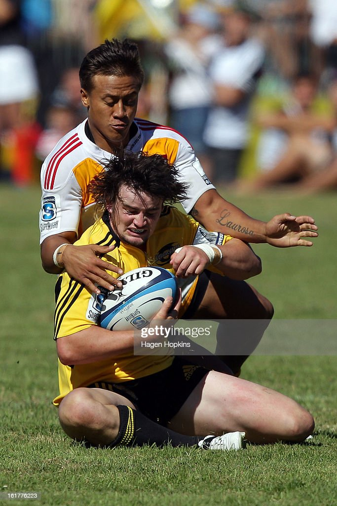 Richard Buckman of the Hurricanes is tackled by Tim Nanai-Williams of the Chiefs during the Super Rugby trial match between the Hurricanes and the Chiefs at Mangatainoka RFC on February 16, 2013 in Mangatainoka, New Zealand.