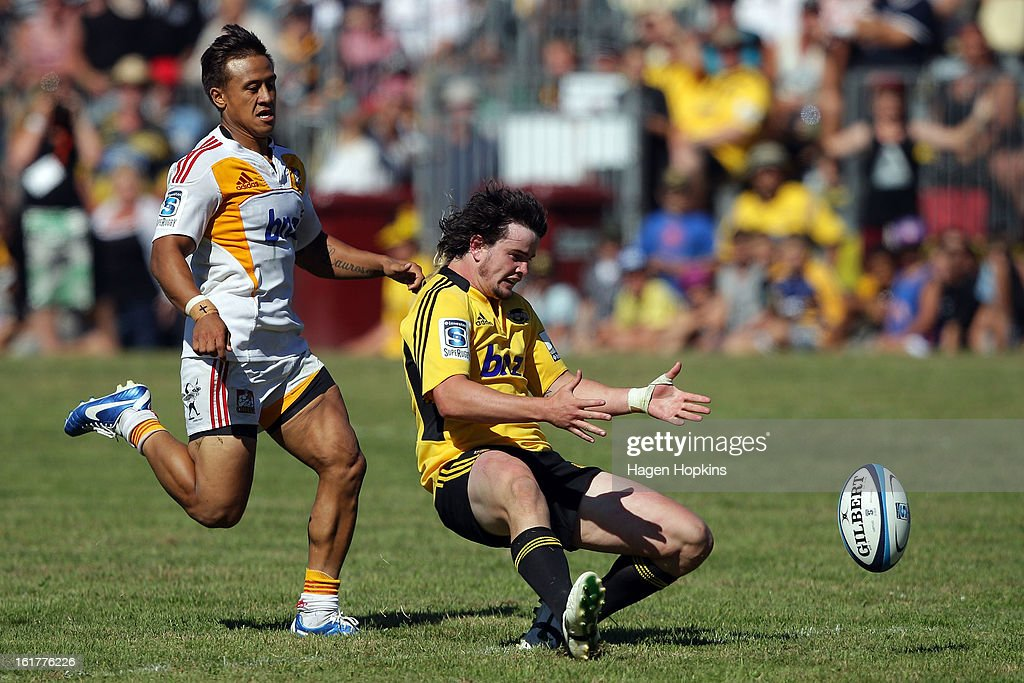 Richard Buckman of the Hurricanes looks to secure a loose ball under pressure from Tim Nanai-Williams of the Chiefs during the Super Rugby trial match between the Hurricanes and the Chiefs at Mangatainoka RFC on February 16, 2013 in Mangatainoka, New Zealand.