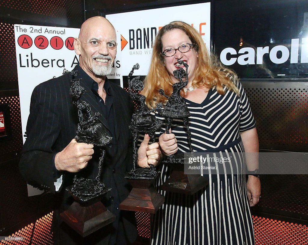 Richard Burgess and Sarah Robertson hold a libera award for Creative Packaging at the 2nd Annual Libera Awards at Highline Ballroom on June 20, 2013 in New York City.